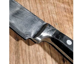 Empuñadura-Servicio de remover 5mm empuñadura de un cuchillo de cocina en LIMA-3.